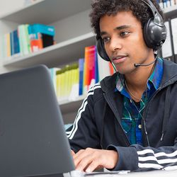 decorative picture: student with headset learning online